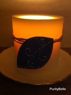 Round pillar candle glows in the dark