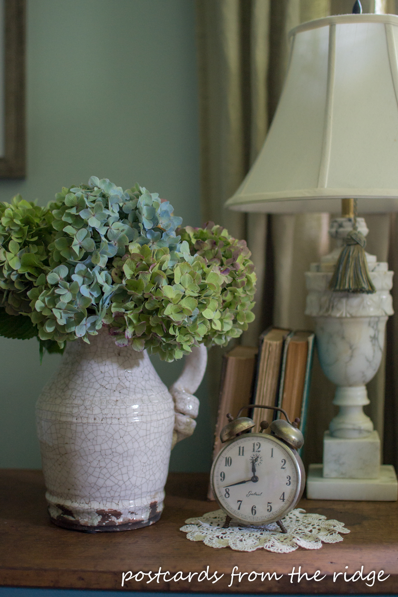Love these hydrangeas and the vintage clock. Lots of great ways to add farmhouse charm to any bedroom. Postcards from the Ridge