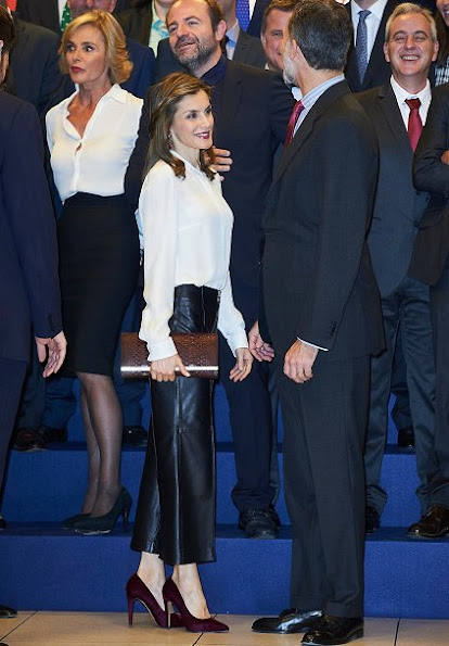 Queen Letizia wore Uterque Nappa Trousers, and Hugo Boss blouse, Magrit suede pumps, Tous earrings