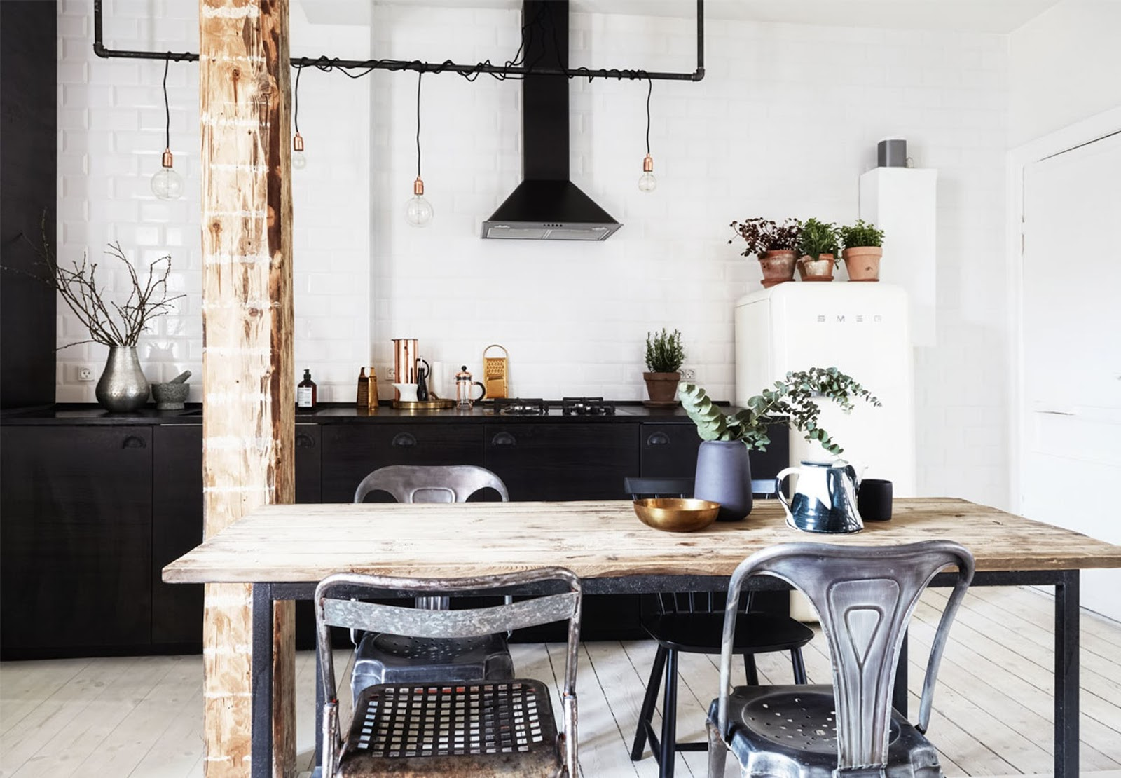 small scandinavian apartment with black kitchen and rustic wood