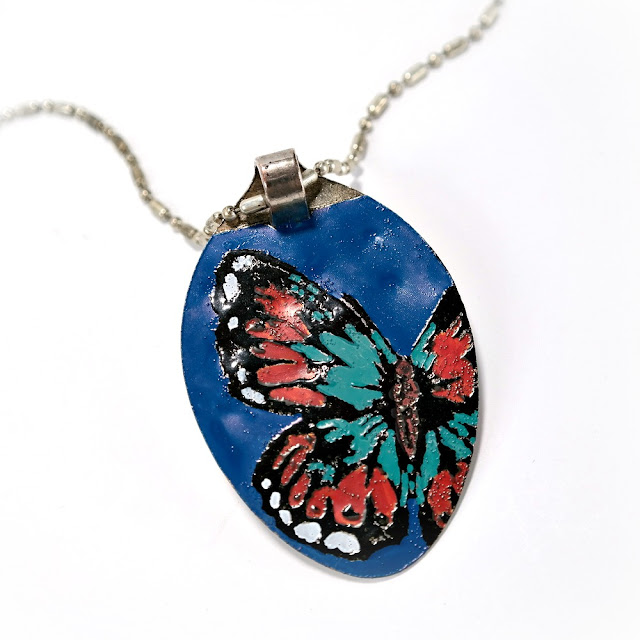 Metal Pendant with Embossed and Hand-Painted Butterfly