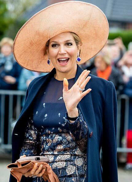 Queen Maxima wore a new embroidered dress by Natan Couture. The company is now officially named Royal Swinkels Family