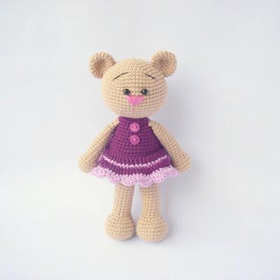 Amigurumi girl bear in purple dress with buttons