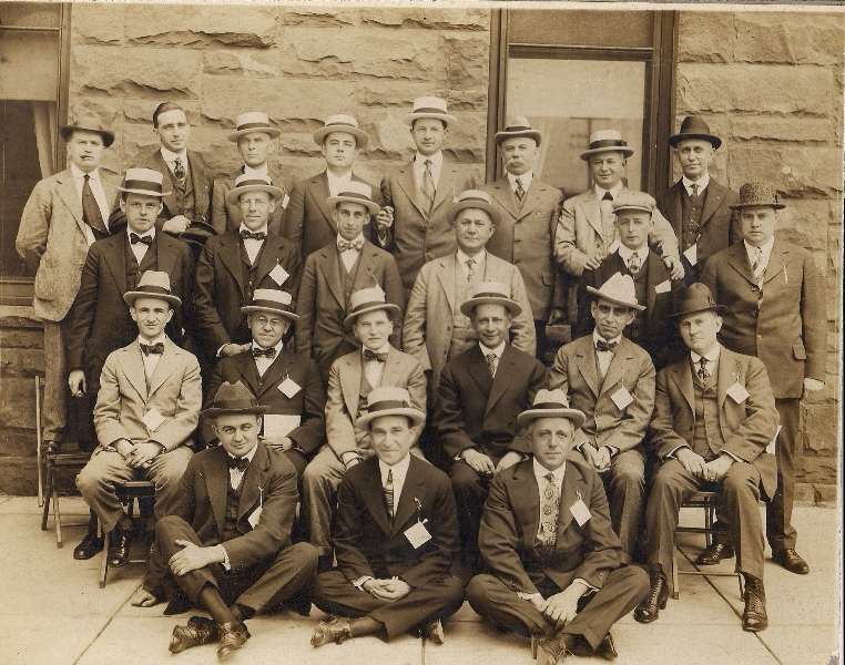 ... group of dapper men wearing boater hats and fedoras. I am thinking this  picture was taken around the 1920s. I wish I knew what is written on the  tags. 9613ae51f55