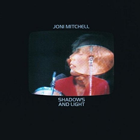 Joni Mitchell - Shadows and Light is a 1980 live double album by the Canadian singer-songwriter Joni Mitchell. It was recorded at the Santa Barbara Bowl in September 1979 on Mitchell's Mingus tour. A film of the concert was also released on VHS, LaserDisc and DVD.