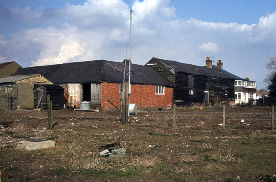 Photograph of Potterells farm buildings and rear of the house in the 1980s - Image from the NMLHS