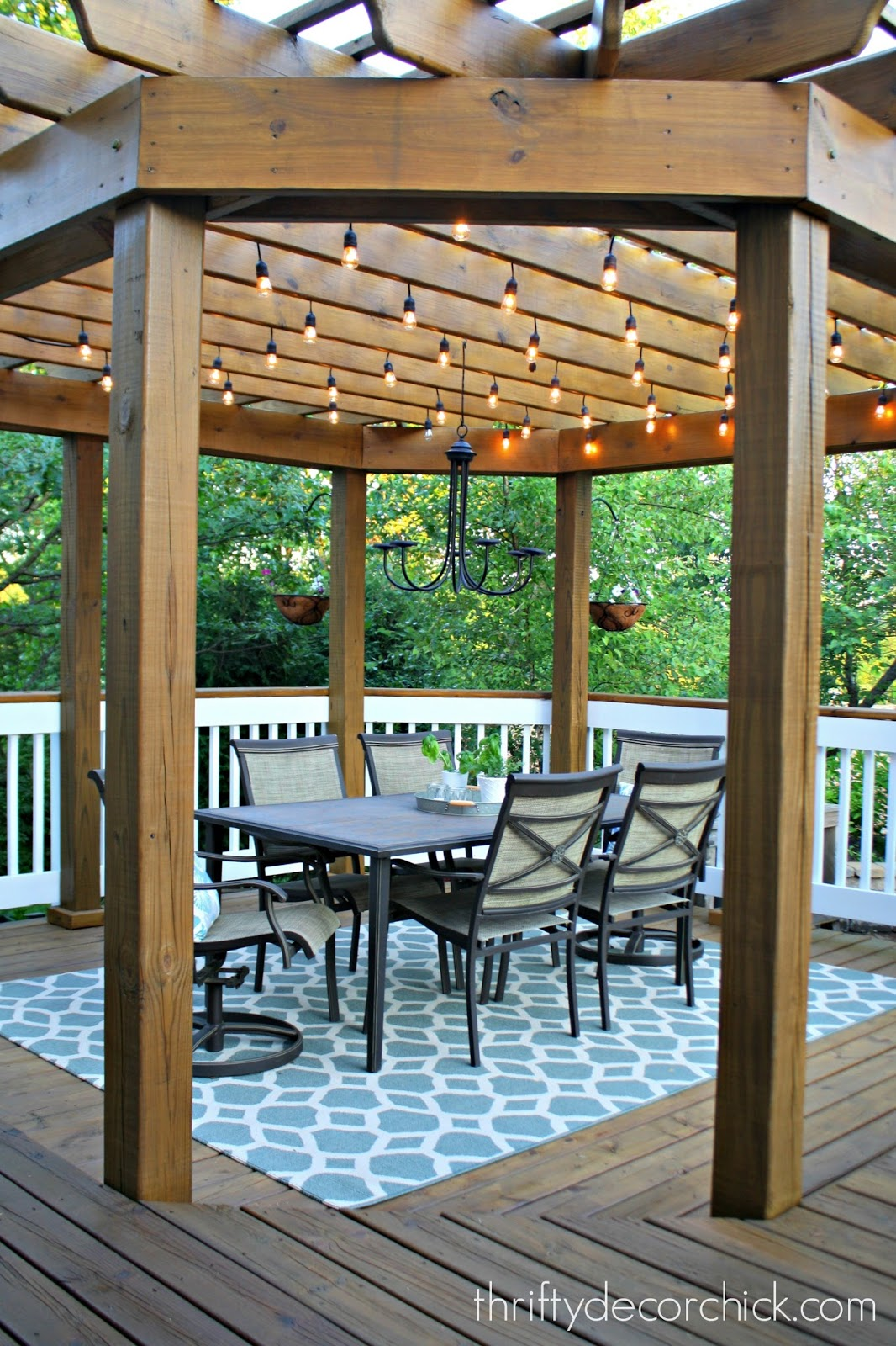 wood pergola with lights on deck