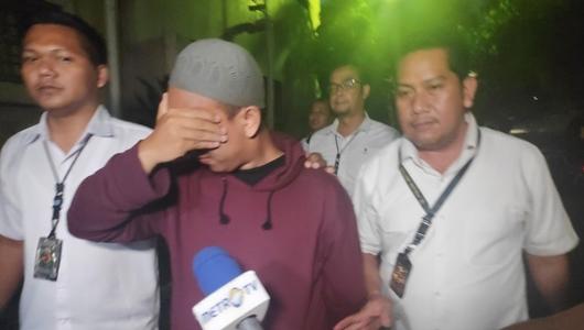 Usai Diperiksa, Pengancam Penggal Jokowi Tutupi Wajah dan Ngaku Menyesal