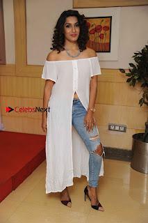 Kannada Model Actress Krishi Thapanda Stills in Ripped Jeans at Eradu Kanasu Movie Press Meet  0013.jpg