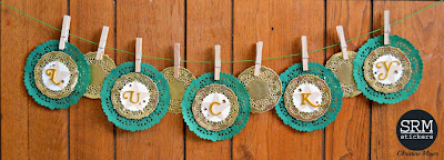 SRM Stickers Blog - St. Patrick's Day Doily Banner by Christine - #banner #stpatrickesday #doilies #golddoilies #punchedpieces #twine #DIY