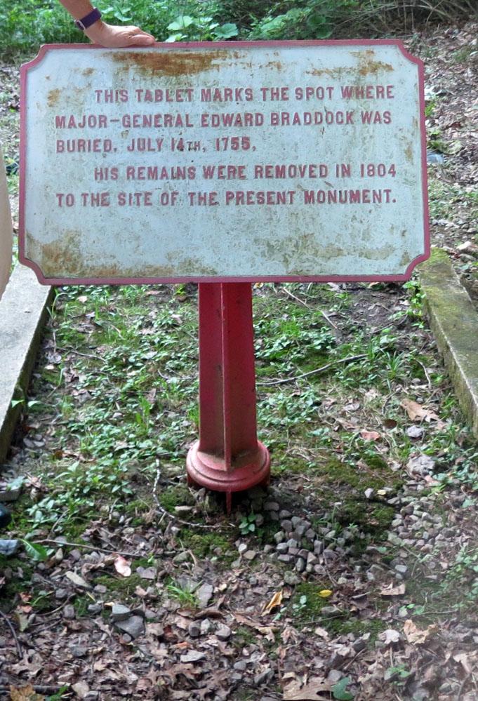 Sign marks original Braddock grave.