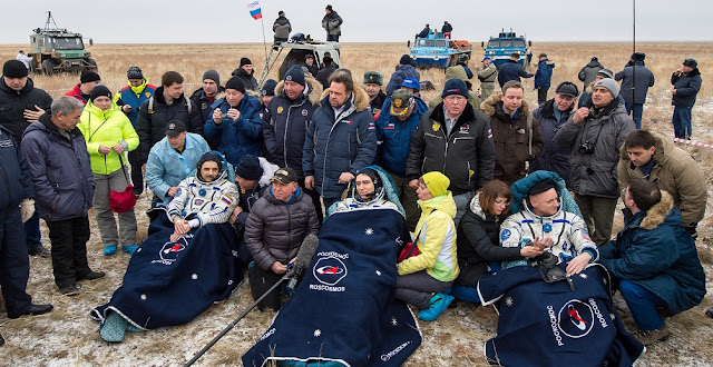 Russian cosmonauts Mikhail Kornienko, left, Sergey Volkov of Roscosmos, center, and Expedition 46 Commander Scott Kelly of NASA, rest in chairs outside of the Soyuz TMA-18M spacecraft just minutes after they landed in a remote area near the town of Zhezkazgan, Kazakhstan on Wednesday, March 2, 2016 (Kazakh time). Kelly and Kornienko completed an International Space Station record year-long mission to collect valuable data on the effect of long duration weightlessness on the human body that will be used to formulate a human mission to Mars. Volkov returned after spending six months on the station. Photo Credit: (NASA/Bill Ingalls)