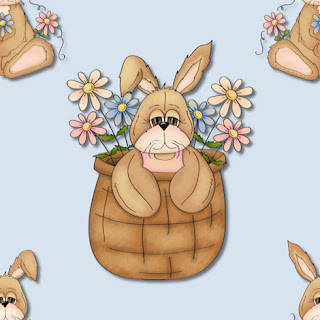 Clipart image of a bunny in an Easter basket with spring flowers