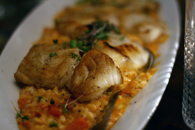 lobster risotto with perfectly cooked chilean sea bass and halibut with chunks of lobster