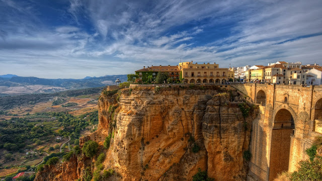 Panaoramic photo of Ancient bridge leading  into the city of Ronda, Spain in the sunset