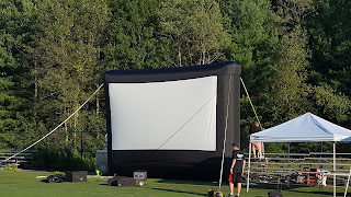 the big screen gets set up