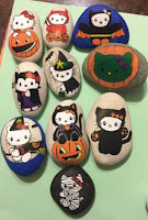 Decoración para Halloween con piedras pintadas kitty cat