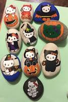 Decoración para Halloween con piedras pintadas kitty cat