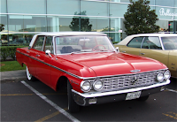 A red 1962 Ford Galaxy sedan