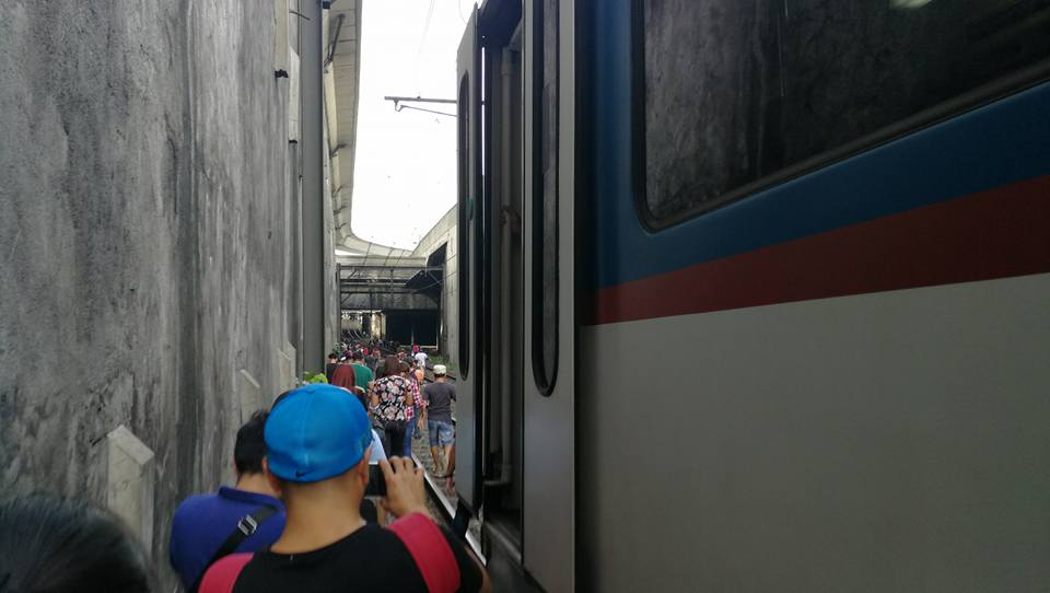 Passengers walk to station after MRT train detaches