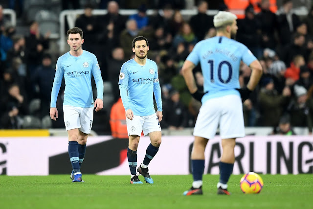 Sergio Aguro, David Silva, Laporte look on as Newcastle shock Premier League champions Manchester city 2-1