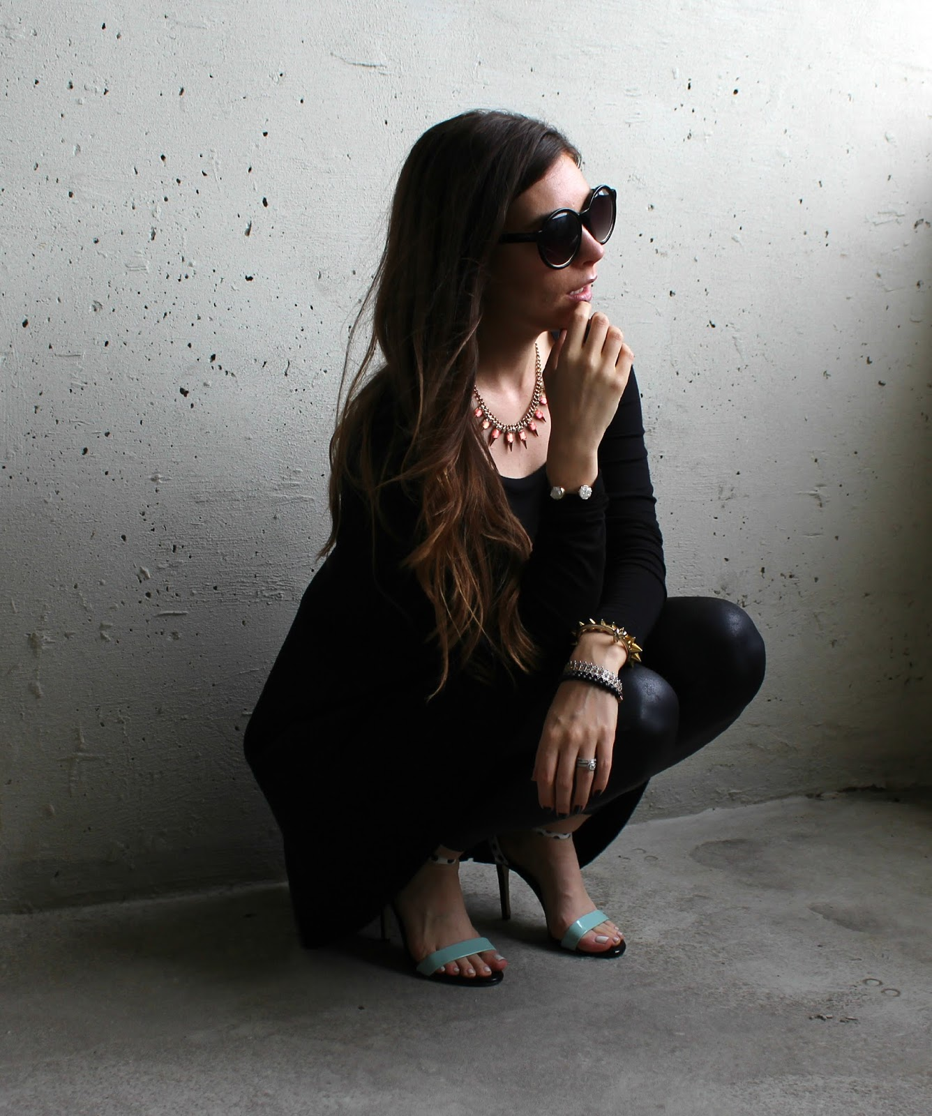 Strappy heels, black cotton dress, black leather pants, oversize sun glasses