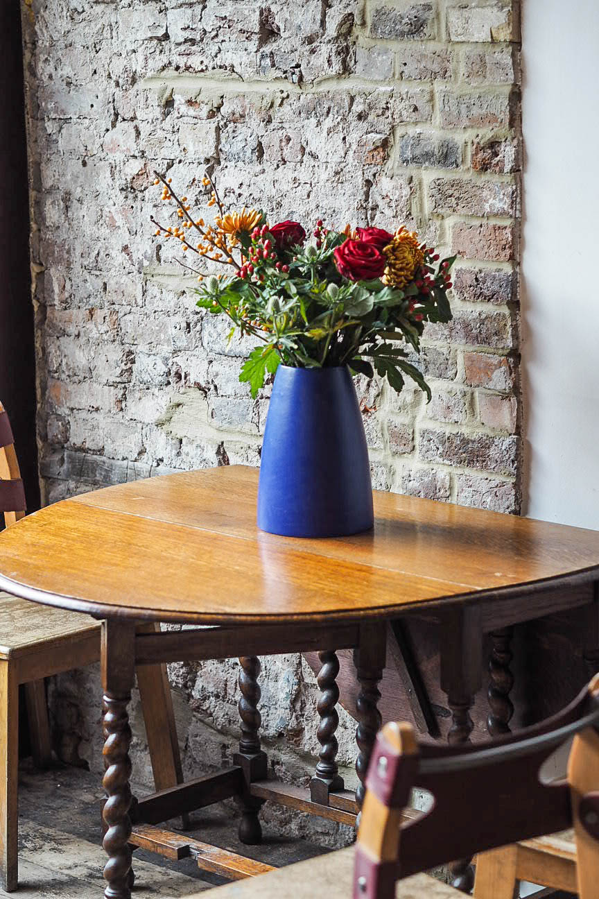 Vase of flowers at Burnt Lemon Bakery