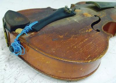 Il est préférable de faire appel à un luthier pour réparer un violon non ?