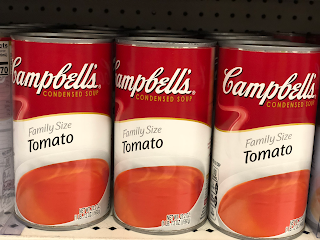 Three cans of Campbell's Tomato Soup