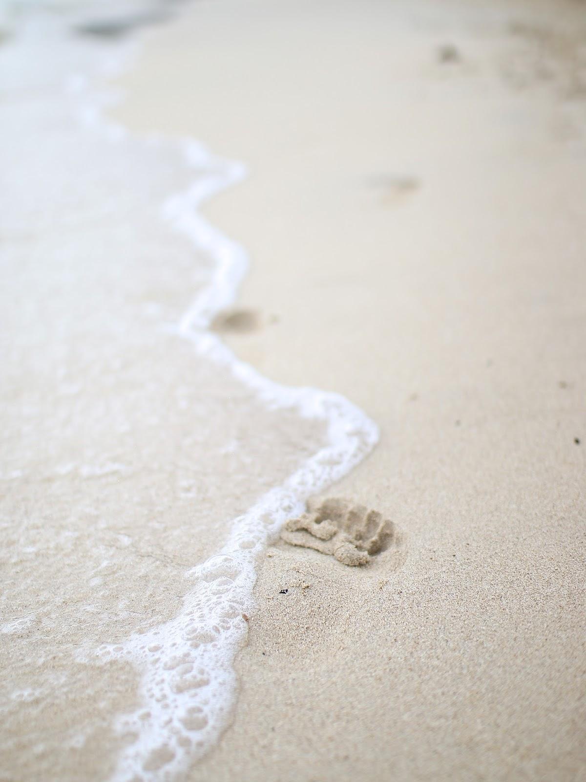 foot steps in the sand in spain