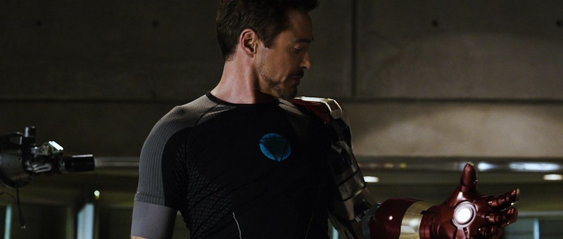 Tony Stark contemplating an Iron Man gauntlet