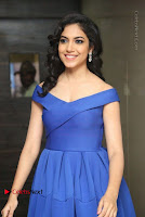 Actress Ritu Varma Pos in Blue Short Dress at Keshava Telugu Movie Audio Launch .COM 0059.jpg