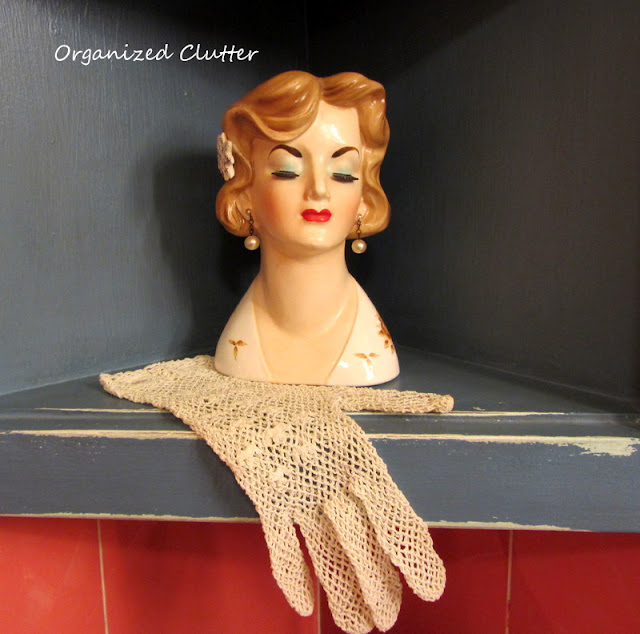 Vintage head vase with lace glove as a doily