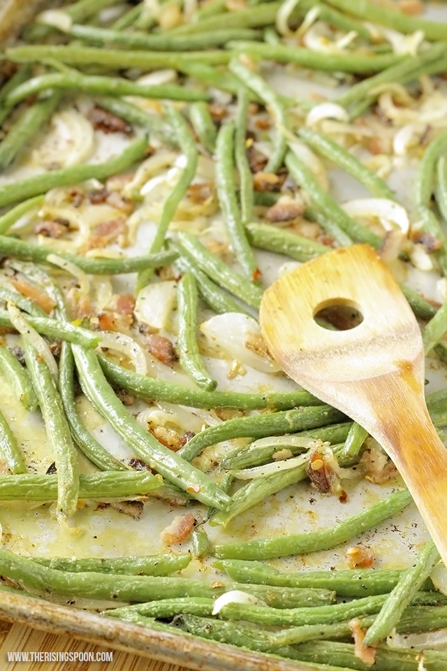 Fresh green beans tossed with thick-cut bacon, sliced onion, and simple spices, then quick-roasted in the oven til tender, slightly caramelized, and crispy around the edges. It's a quick and easy side dish recipe for any night of the week!