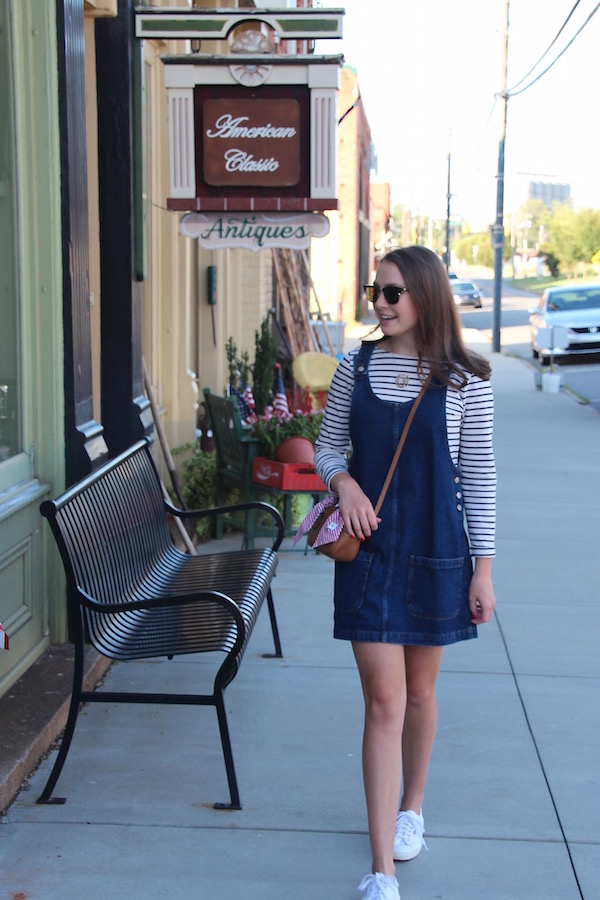 Gimme Glamour: Denim Jumper. Overall dress, striped shirt, white tennis shoes
