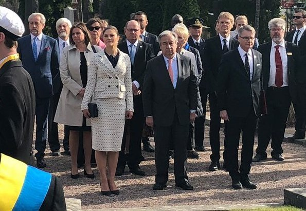 Crown Princess Victoria carried Quidam Clutch, wore Gant Vertical Striped Bow Blouse, and Alexander McQueen double-breasted printed blazer and skirt