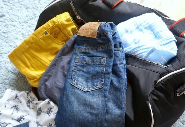 gym bag with baby clothes spilling out