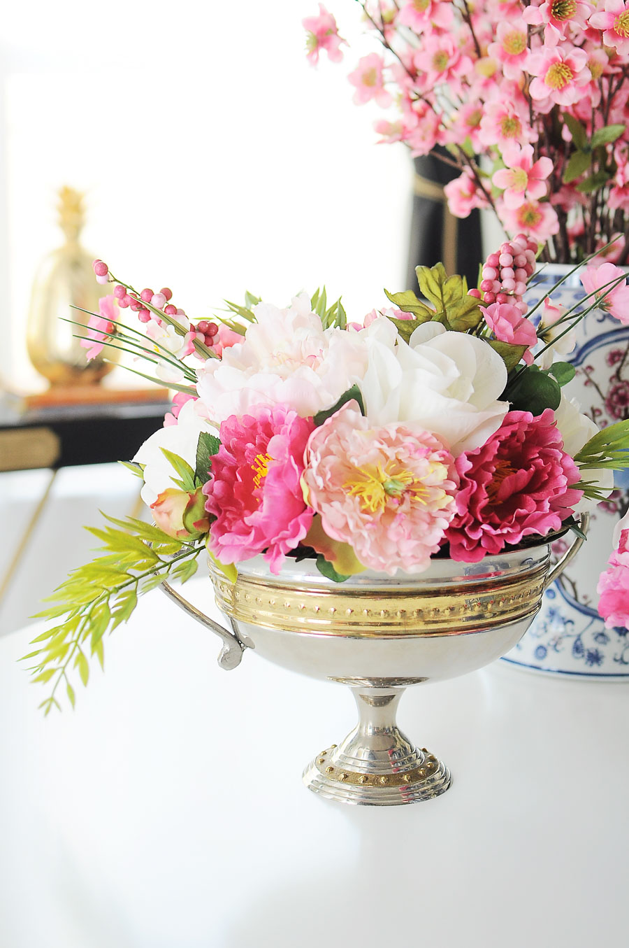 DIY pink and white peony faux floral arrangement tutorial using a trophy vase and dry floral foam. Love this idea for spring home decor, tablescapes or a centerpiece.