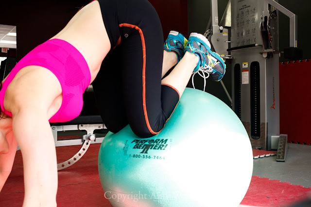 woman working out on stability ball