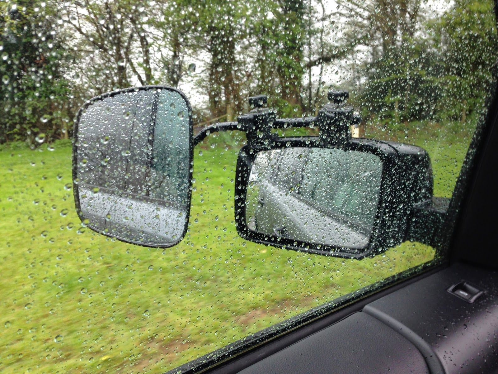 Rain on a car window and wing mirror