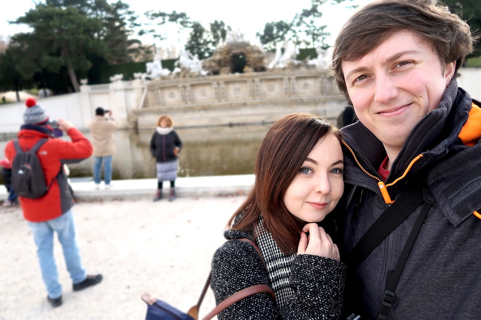 couple next to fountain
