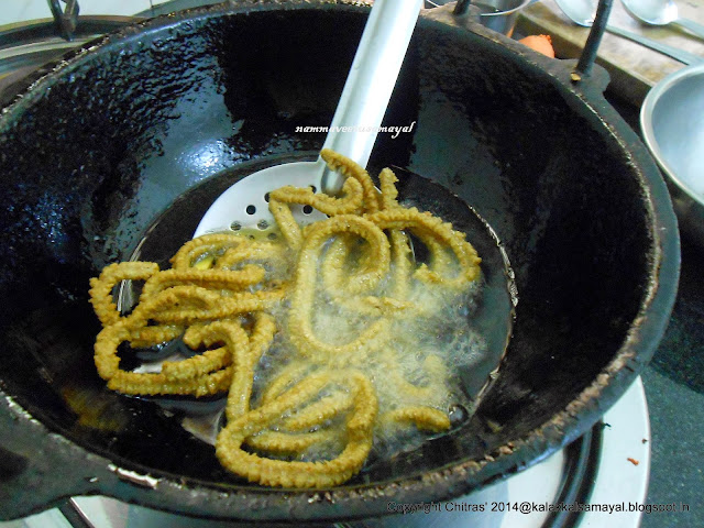 Flip Kambu Murukku [ Pearl Millet Murukku ] frying in the oil to fry the other side