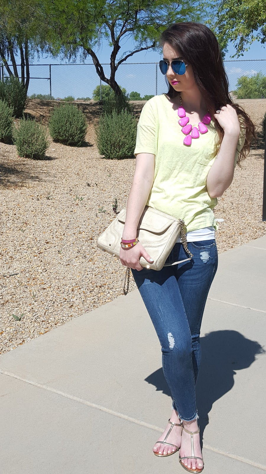 bright Spring and Summer outfit with neon tee, pink Kendra Scott necklace, and blue aviators