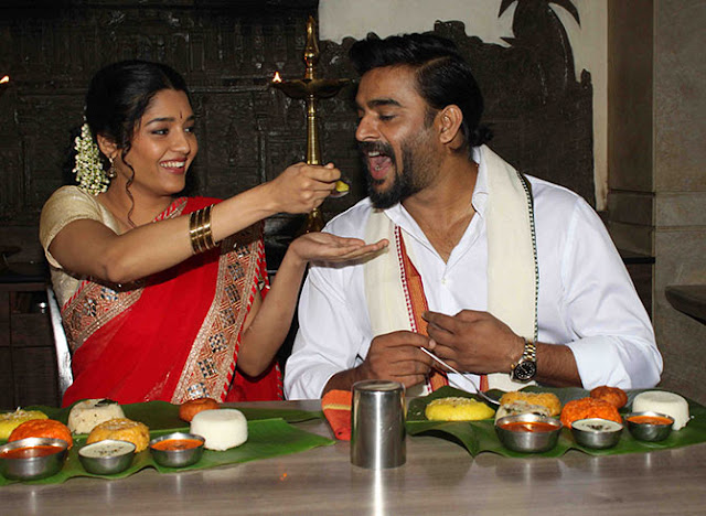 Rithika singh in red half saree feeding to Madhavan