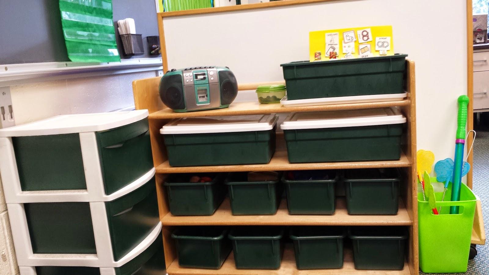 photo of green bins on shelves
