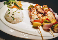Hawaiian chicken kebabs kabobs with parsley butter rice and sauteed vegetables
