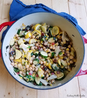 enameled dutch oven filled with mixed veggies and chickpeas