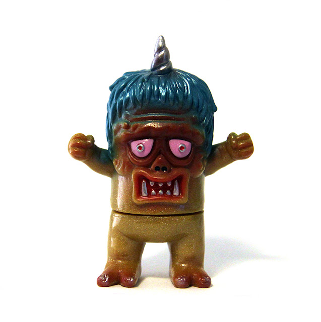 https://www.tenacioustoys.com/products/rampage-toys-uglier-unicorn-gold-sparkle-exclusive-edition-3-25-inch-sofubi-vinyl-figure