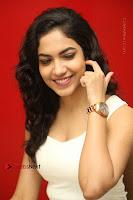 Actress Ritu Varma Stills in White Floral Short Dress at Kesava Movie Success Meet .COM 0208.JPG