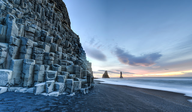 Frozen Reynisfjara beach on Iceland's south coast during 5-day winter itinerary